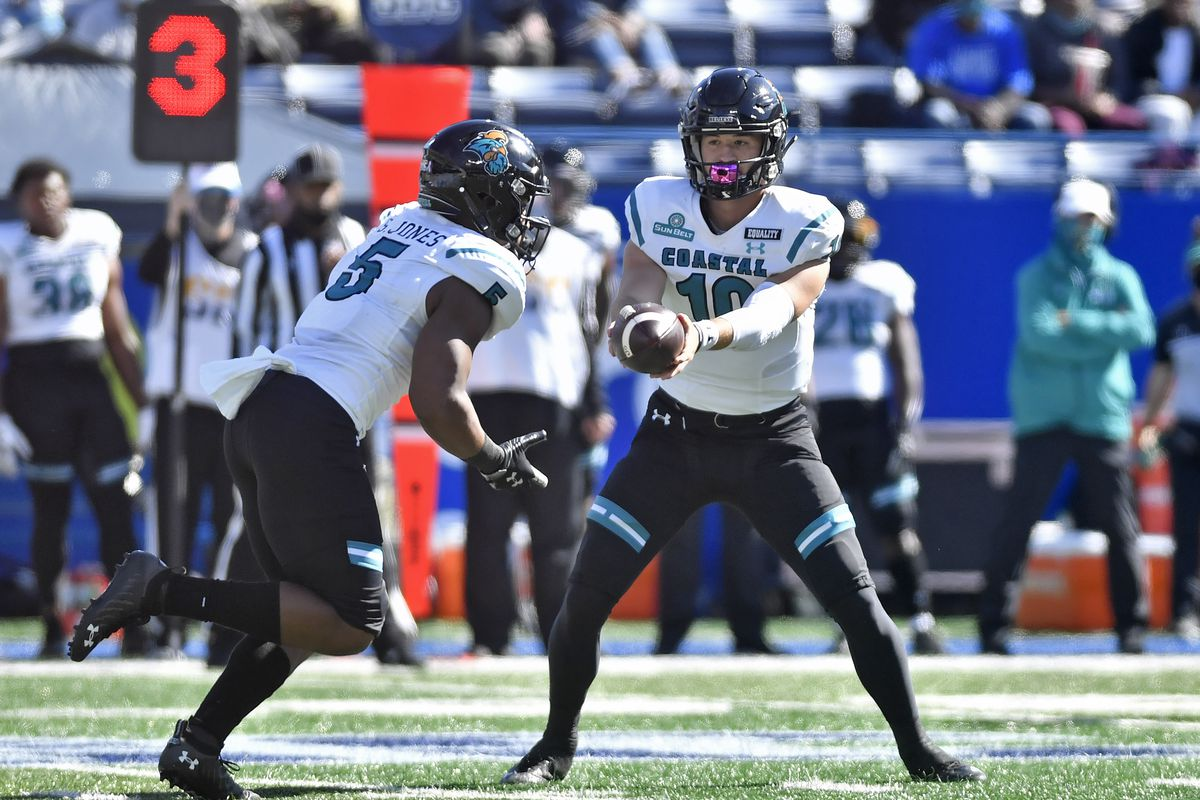 Coastal Carolina quarterback Grayson McCall looks to make a handoff during the first quarter of a college football game between the Coastal Carolina Chanticleers and Georgia State Panthers on October 31, 2020, at Center Parc Credit Union Stadium in Atlanta, GA.
