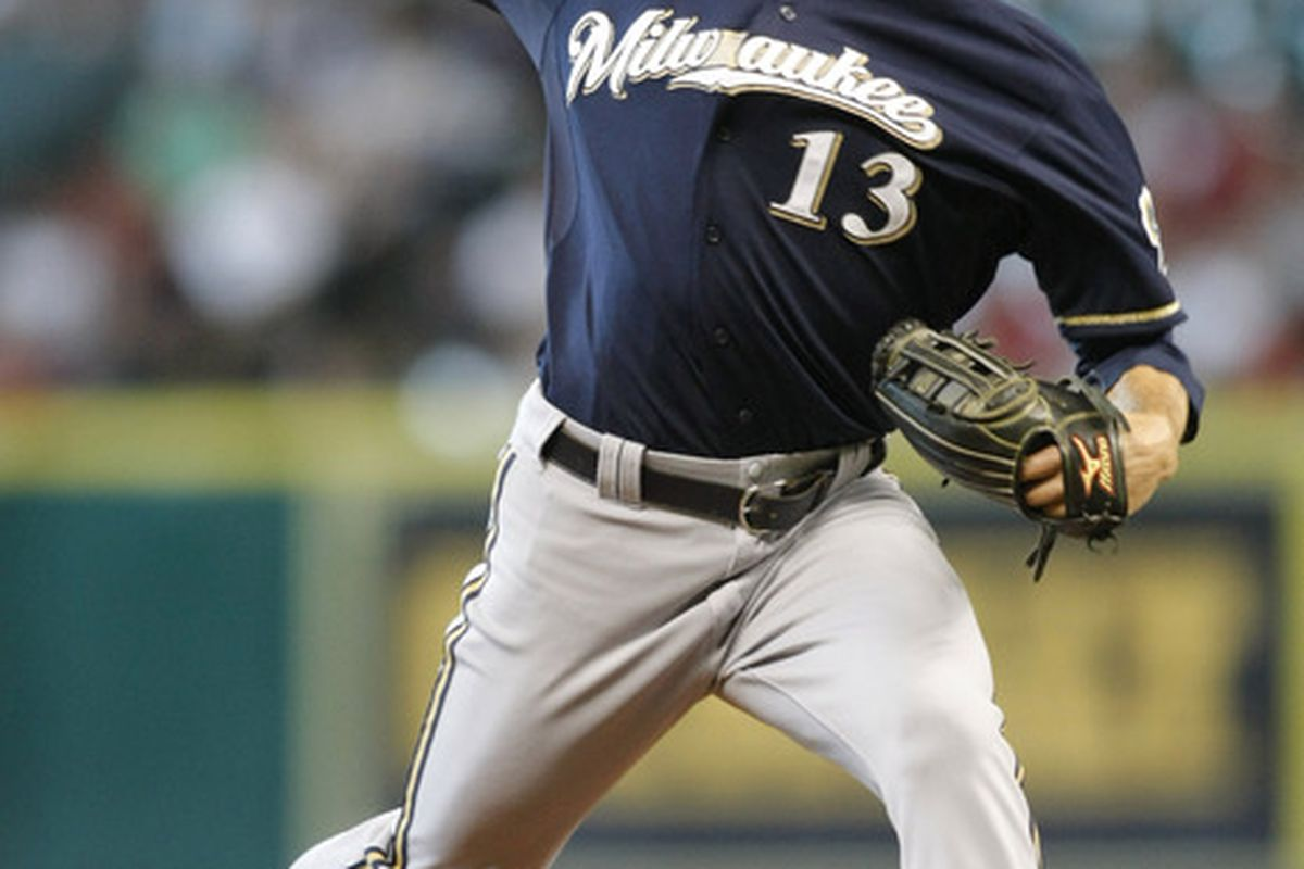 July 7, 2012; Houston, TX, USA; Milwaukee Brewers starting pitcher Zack Greinke (13) throws a pitch against the Houston Astros in the first inning at Minute Maid Park. Mandatory Credit: Brett Davis-US PRESSWIRE