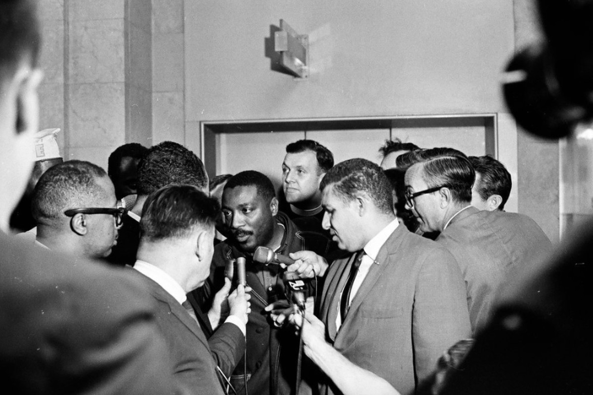 Dick Gregory and others gathered outside of the Mayor's Office in Chicago