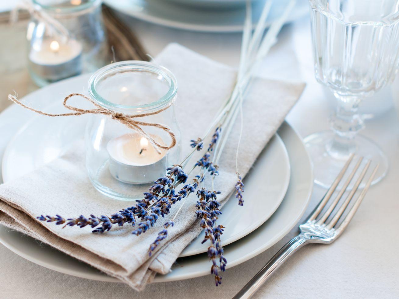 Tea lights add a soft glow to this dinner setup.