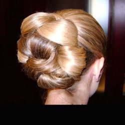 """<b>Peggy Loakim,</b> <a href=""""http://www.karmaerwingomez.com"""">Karma Beauty Lounge:</a> """"In my 24 years of working with brides, styles have come and gone, but this is a classic look. With softer and fuller curls entwined into a classic pulled-back bun, thi"""