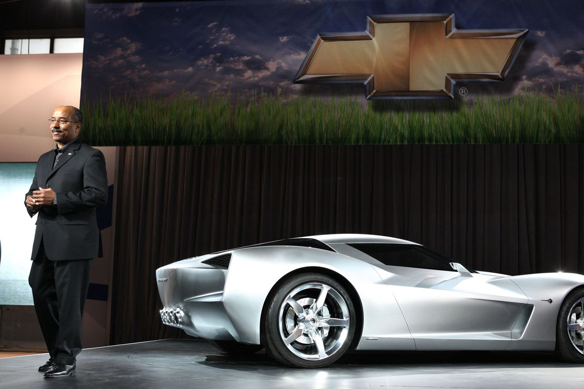 Ed Welburn standing beside the Corvette Stingray concept in 2009.