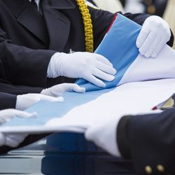 Pallbearers fold the flag that drapes Officer Jimenez's casket. | Ashlee Rezin/Sun-Times