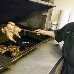 David Reynosa checks his chickens