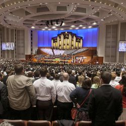 Audience members stand to sing during the morning session of 183 annual General Conference of the Church of Jesus Christ of Latter Day Saints Saturday, April 6, 2013 inside the Conference Center.