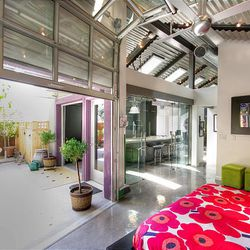 The inside of this Sugar House bungalow was gutted and garage doors added to create what looks like a New York City loft.