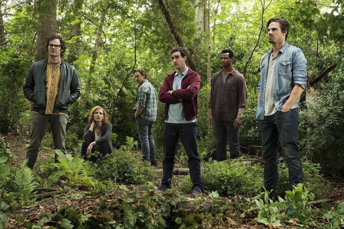 Richie (Bill Hader), Beverly (Jessica Chastain), Bill (James McAvoy), Eddie (James Ransone), Mike (Isaiah Mustafa), and Ben (Jay Ryan) convene in the woods.