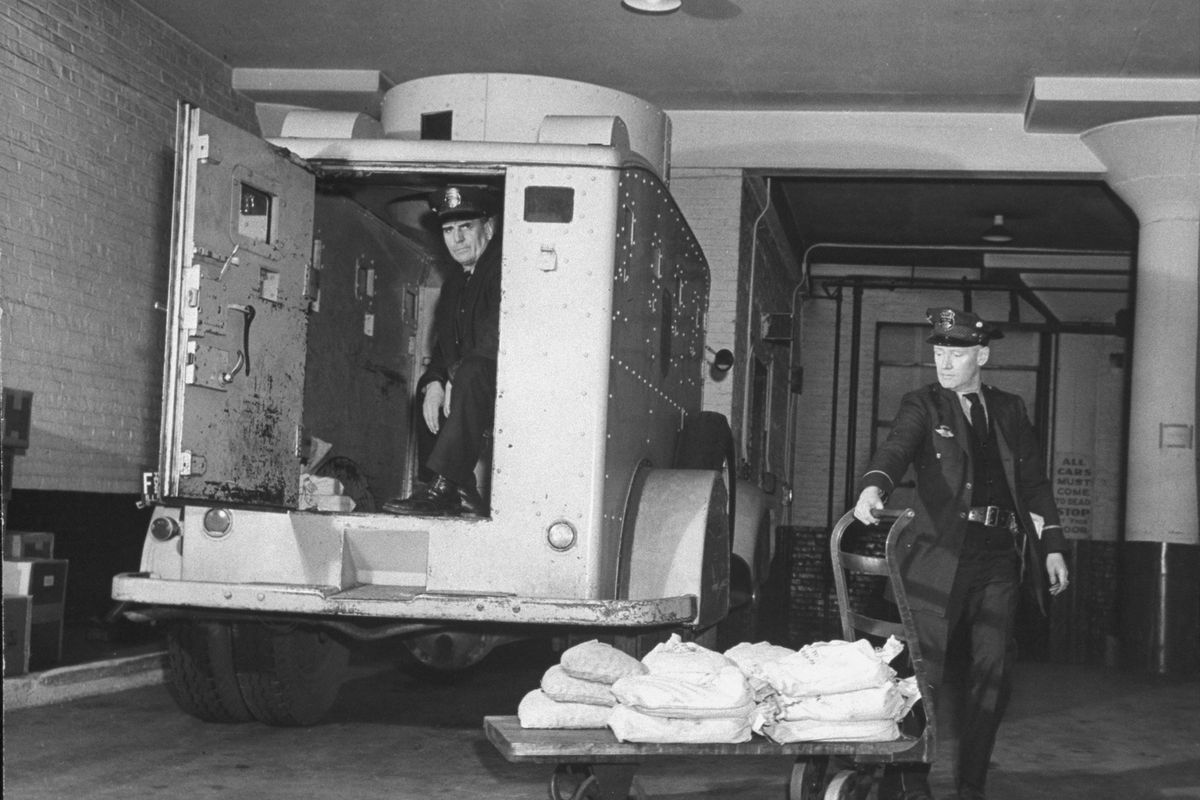 Guards unloading an armored truck.