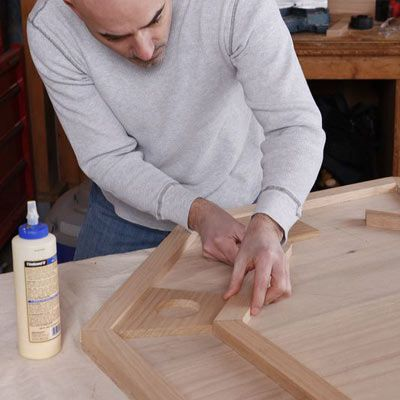 Person carefully installing the inner edge on a DIY poker table.