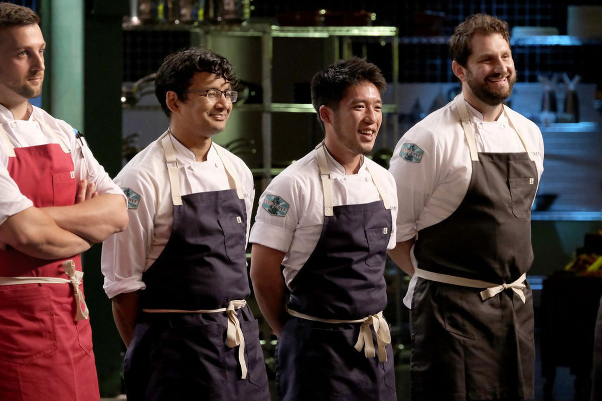 Shota Nakajima (center) lines up in a gray apron with fellow contestants (from left to right) Gabriel Pascuzzi, Avishar Barua, and Gabe Erales.