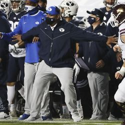Brigham Young Cougars head coach Kalani Sitake holds his players back after an interception for a touchdown in Provo on Saturday, Oct. 24, 2020.