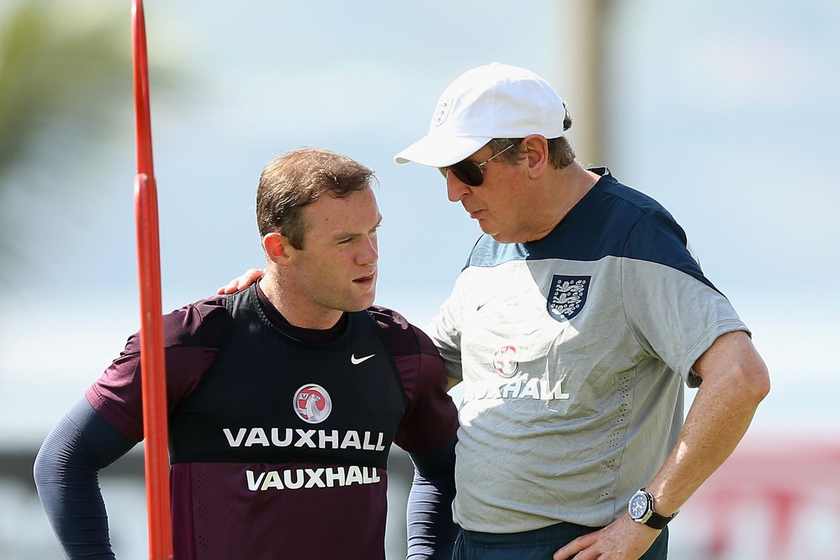 Rooney listens as Hodgson tells him that corner kicks actually need to be put in play and not into the stands