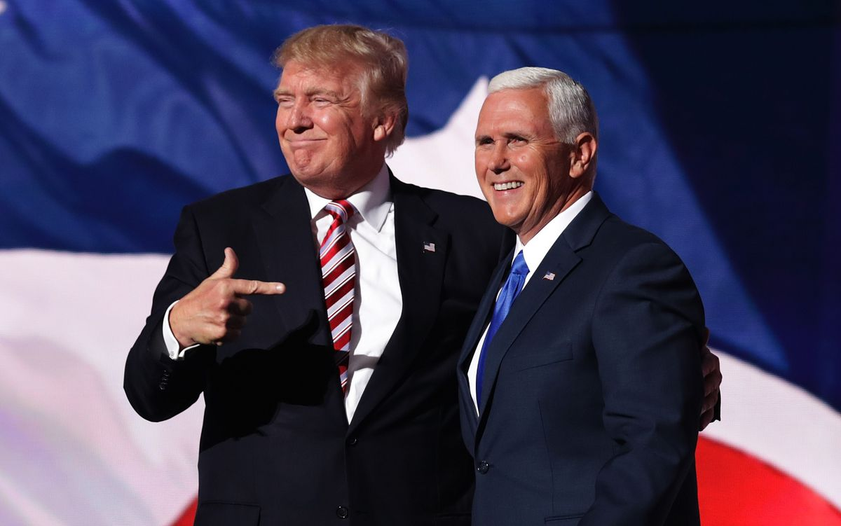 Vice President Mike Pence and president-elect Donald Trump celebrate the 2016 victory at Trump tower.