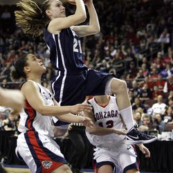 Brigham Young Cougars guard Lexi Eaton (21) drives on Gonzaga Bulldogs guard Taelor Karr (12)  in the West Coast Conference finals in Las Vegas  Monday, March 5, 2012.  BYU won the title and will advance to the NCAA tournament.