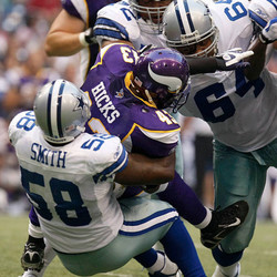 """He found himself on the Redskins roster before spending the rest of the 2007 season in Dallas: """"Minnesota Vikings' Maurice Hicks is stopped by Dallas Cowboys' Tyson Smith as Junior Siavii closes in during a NFL preseason game at Texas Stadium in Irving, Texas, on Thursday, August 28, 2008."""""""