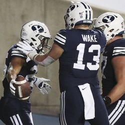 Brigham Young Cougars running back Tyler Allgeier (25) celebrates his touchdown against Texas State with Brigham Young Cougars tight end Masen Wake (13) in Provo on Saturday, Oct. 24, 2020.