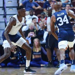 Ray Allen is guarded by Amida Brimah.
