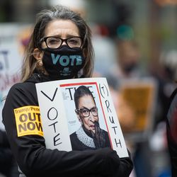 Ruth Novak holds a sign with the late Supreme Court Justice Ruth Bader Ginsburg's picture during the Women's March.
