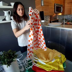 Nicole Christensen packages clothes that she is selling on Instagram at her home in Pleasant Grove on Thursday, Sept. 19, 2013.