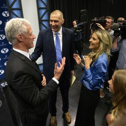 BYU President Kevin J Worthen talks with new men's basketball head coach Mark Pope and his wife Lee Anne after a press conference at the BYU Broadcast building in Provo on Wednesday, April 10, 2019.