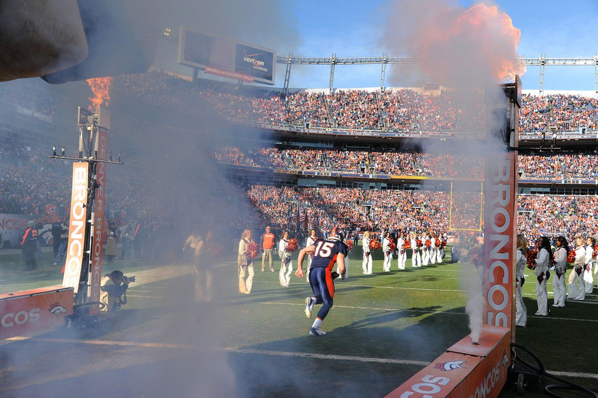 Tim Tebow of the Denver Broncos runs out of the tunnel prior to the game against the Kansas City Chiefs at Sports Authority Field at Mile High on January 1, 2012.  (Photo by Garrett W. Ellwood/Getty Images)