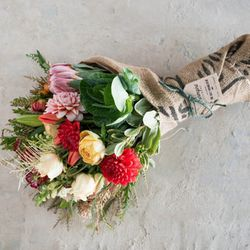<b>Farmgirl Flowers</b> features a beautiful <b>bouquet of mixed flowers</b> that are hand-wrapped in 100% biodegradable reused coffee bags. Choose from small (12-15 stems), medium (22-25 stems) to large (32-35) bouquets. The company will start accepting