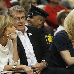 UConn head coach Geno Auriemma chats with UConn associate head coach Chris Dailey during the Notre Dame Fighting Irish vs UConn Huskies women's college basketball game in the Women's Jimmy V Classic at the XL Center in Hartford, CT on December 3, 2017.