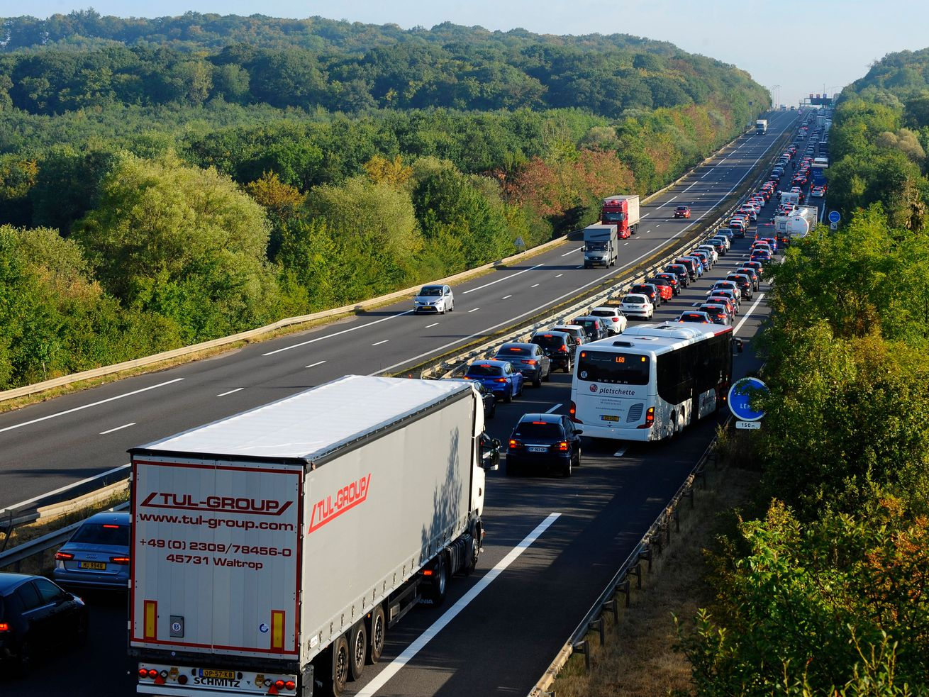 Vehicles stand in a traffic jam near the France-Luxembourg border in Zoufftgen, eastern France on early August 2, 2018, as people are on their way to work.