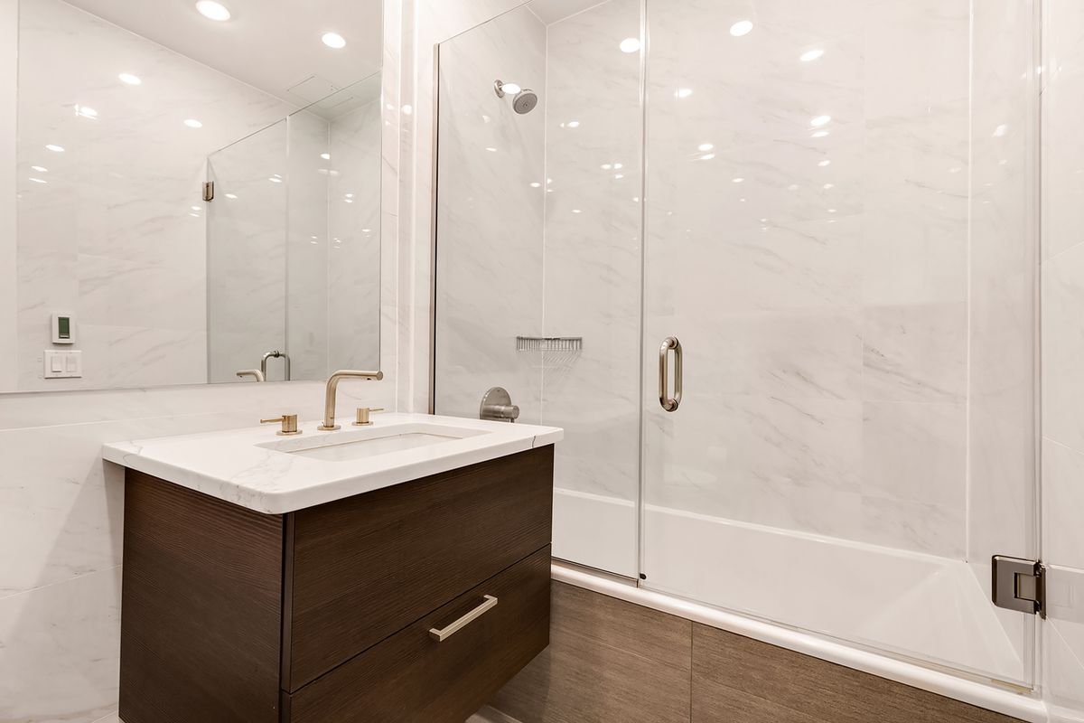 A bathroom with marble tiles in its walls.