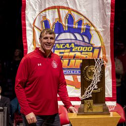 Forward Mark Vershaw standing with the Final Four plaque