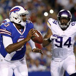 Aug 16, 2013; Orchard Park, NY, USA; Buffalo Bills quarterback E.J. Manuel (3) drops to pass as Minnesota Vikings defensive end Lawrence Jackson (94) rushes during the second half at Ralph Wilson Stadium. Bills beat the Vikings 20-16.