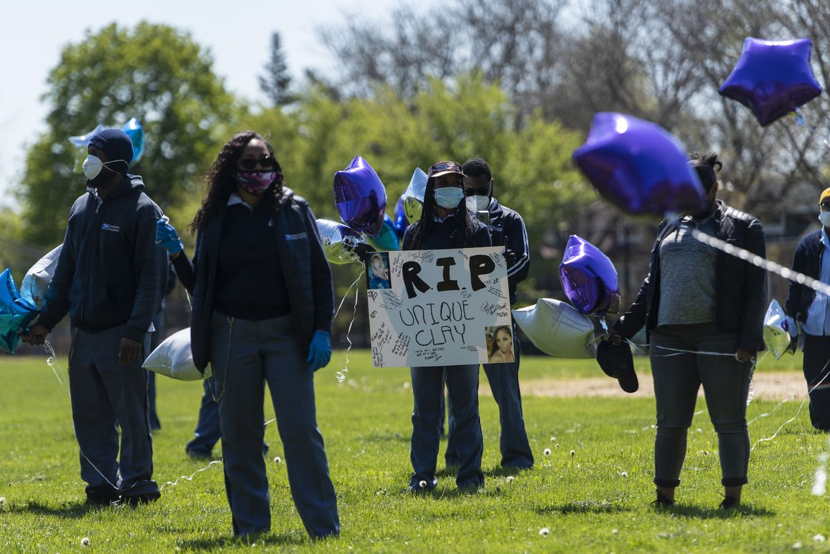 Postal workers from around the city gather at Kilbourn Park for a memorial for Unique Clay.