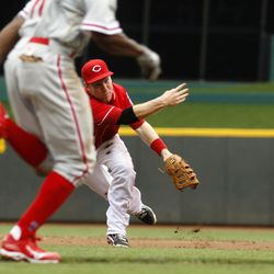 Cincinnati Reds third baseman Todd Frazier, right, throws out Philadelphia Phillies' Juan Pierre, left, at first base in the third inning  in the first inning during a baseball game, Monday, Sept. 3, 2012, in Cincinnati.