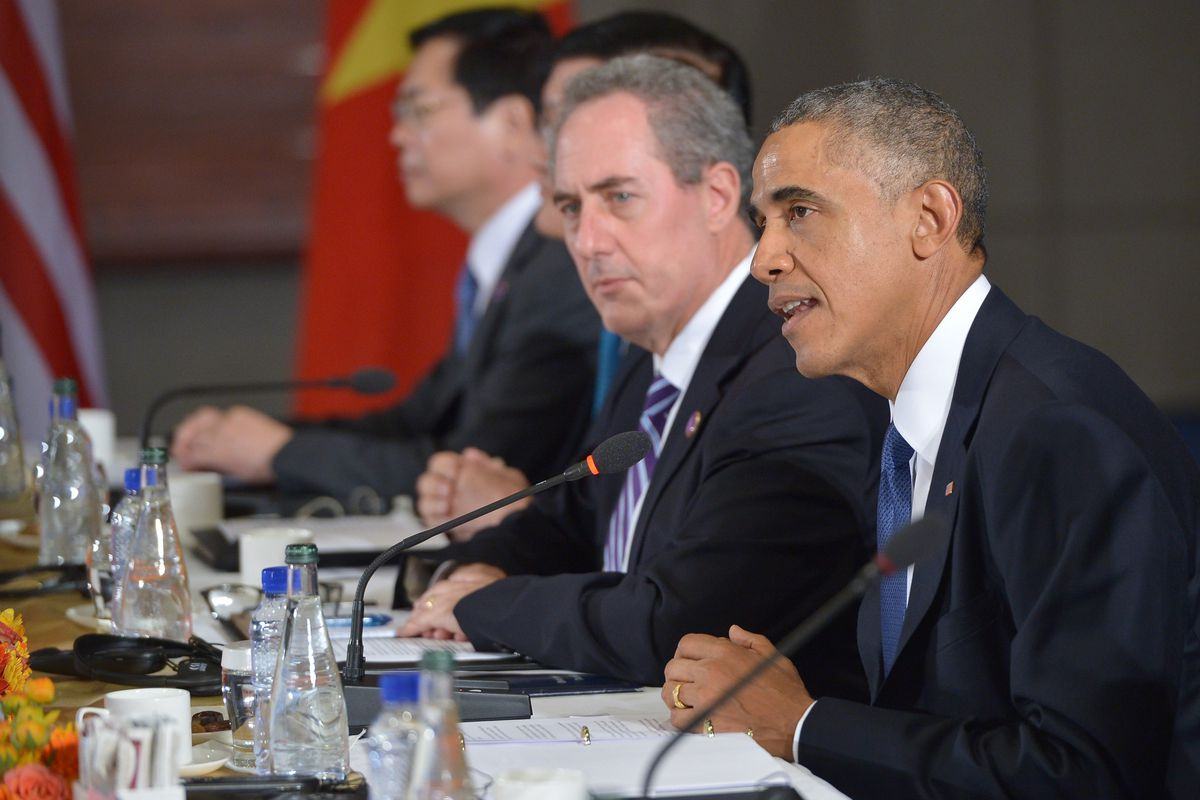 US Trade Representative Michael Froman and President Obama speak to leaders of other TPP countries in November 2014.