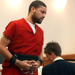 Troy Graves stands to address the court before he was sentenced Wednesday, July 31, 2002, in court in Fort Collins, Colo. Graves pleaded guilty in May to four counts of sexual assault, two counts of unlawful sexual contact, first-degree kidnapping and second-degree burglary. He was earlier sentenced to life on the kidnapping charge. (AP Photo/Pool, Sherri Barber)