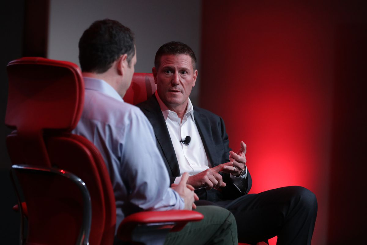Disney's Kevin Mayer sitting onstage with Recode's Peter Kafka at the 2019 Code Media conference.