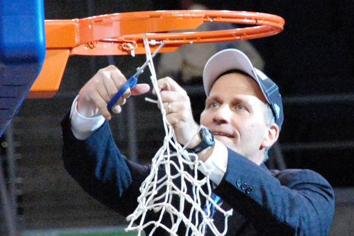 Bob MacKinnon, new coach of the New Jersey Nets' D-League affiliate Springfield, shown here cutting down the <em>nets</em> after winning the 2008-09 D-League Championship as head coach of the Colorado 14ers.