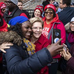 Presidential candidate U.S. Sen. Elizabeth Warren (D-MA) takes selfies with supporters as she joins striking Chicago Teachers Union and SEIU Local 73 members for a speech on the picket line outside Oscar DePriest Elementary School on the West Side, Tuesday morning, Oct. 22, 2019.