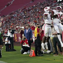 Utah wide receiver Money Parks (10) celebrates his touchdown reception with running back TJ Pledger during the first half of the team's NCAA college football game against Southern California on Saturday, Oct. 9, 2021, in Los Angeles.