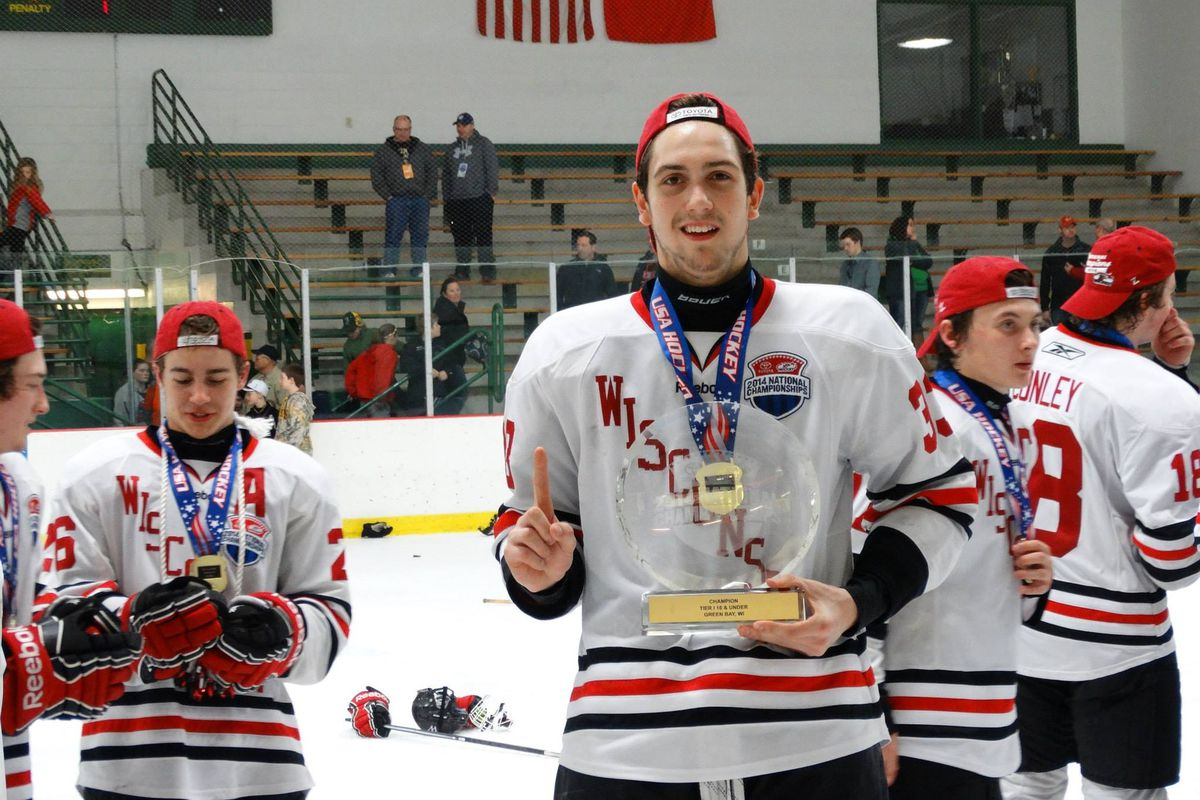 Adam Parsells poses after winning the USA Hockey Tier 1 national championship with Team Wisconsin.
