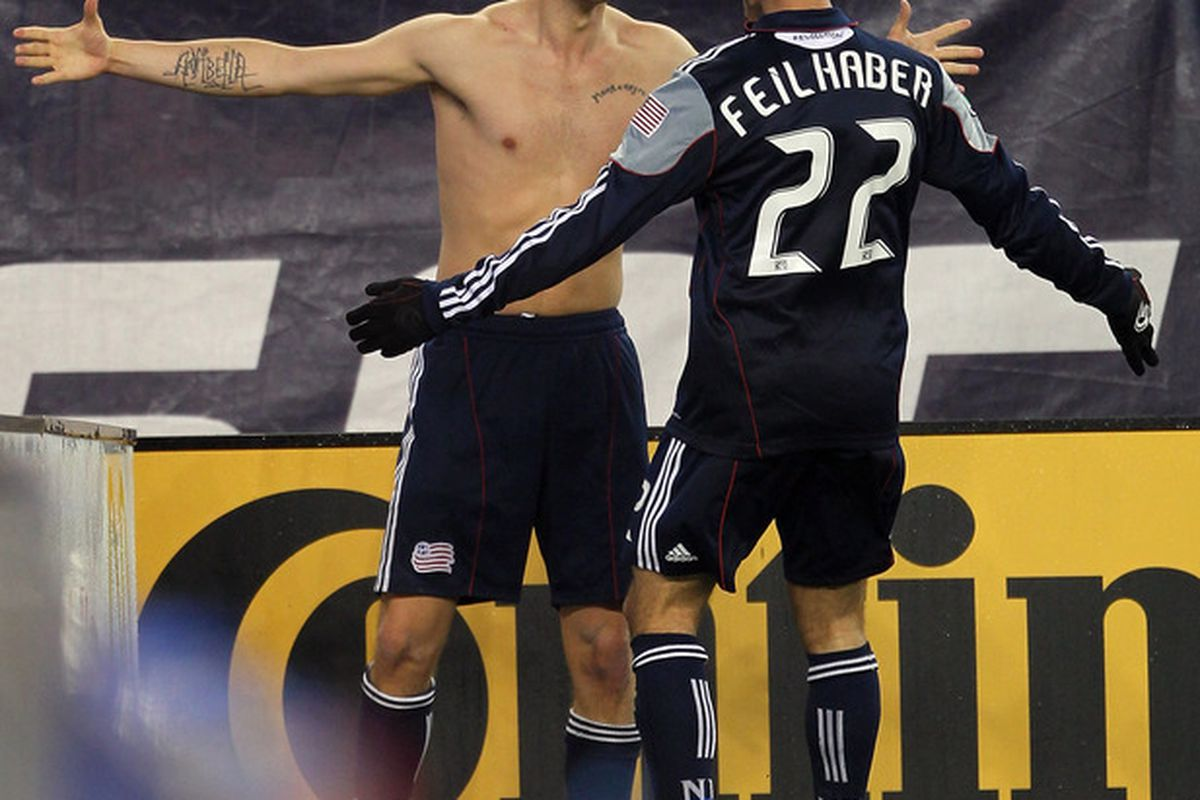 FOXBORO, MA - APRIL 23:  Rajko Lekic and Benny Feilhaber celebrate the Dane's winning goal, his first for the club. Feilhaber tallied an earlier assist. (Photo by Jim Rogash/Getty Images)