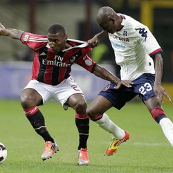 AC Milan midfielder Kevin Constant, left, of Guinea, challenges for the ball with Cagliari forward Victor Ibarbo, of Colombia, during the Serie A soccer match between AC Milan and Cagliari at the San Siro stadium in Milan, Italy, Wednesday, Sept. 26, 2012.