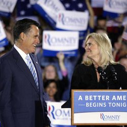 Republican presidential candidate, former Massachusetts Gov. Mitt Romney and wife, Ann, take the stage at an election night rally in Manchester, N.H., Tuesday, April 24, 2012.