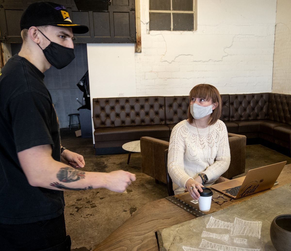 Nick Smith, a barista at Cirque Coffee, chats with Bri Seely at the shop in the Pearl District just outside of downtown Tulsa, Okla., on Jan. 9, 2021. Seely moved to Tulsa as part of the George Kaiser Family Foundation's Tulsa Remote.