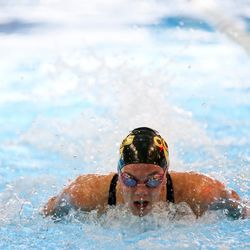 Cottonwood's Rhyan White swims in the girls' 100-yard butterfly at the 5A state swimming meet at the South Davis Recreation Center in Bountiful on Saturday, Feb. 10, 2018.