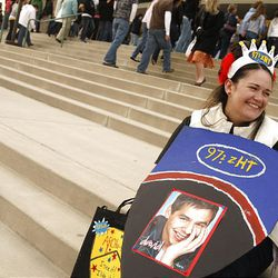 Mindy Taylor is all smiles as she waits to enter the E Center where David Archuleta performed Friday night. Taylor won second-row tickets from the radio station 97.1 ZHT to see David Archuleta perform.