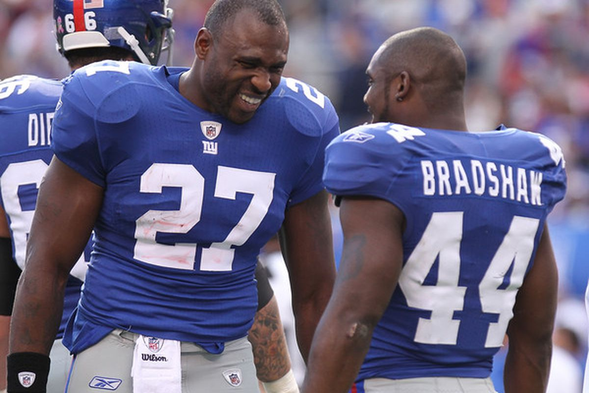 Brandon Jacobs (27) of the New York Giants talks with Ahmad Bradshaw (44) against the Detroit Lions at New Meadowlands Stadium on October 17 2010 in East Rutherford New Jersey.  (Photo by Nick Laham/Getty Images)
