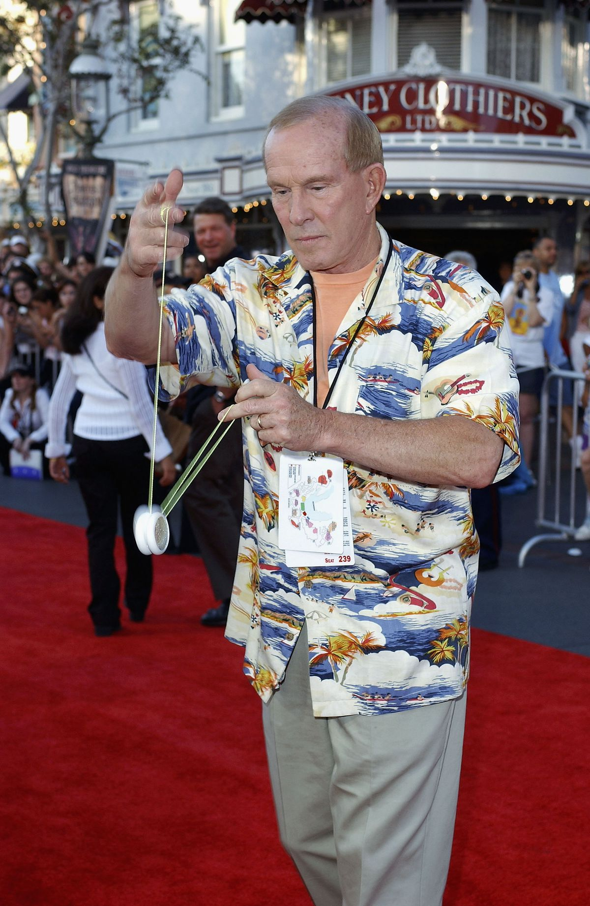 Tom Smothers plays with a yo-yo at the Pirates of the Caribbean premiere