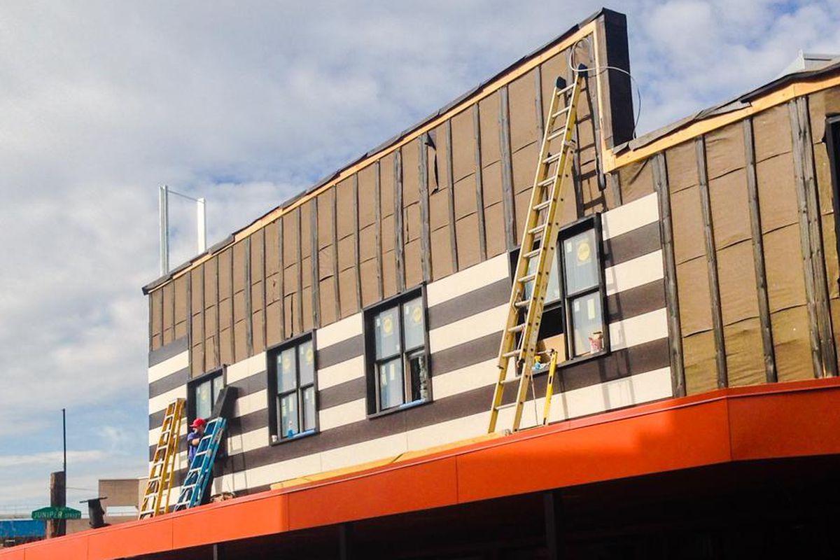 Facade painting is underway.