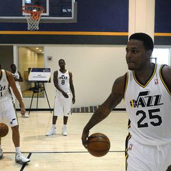 The Jazz's Brandon Rush (25) and the rest of his teammates shoot hoops in between photos during media day at the Zions Bank Basketball Center on Sept. 30.